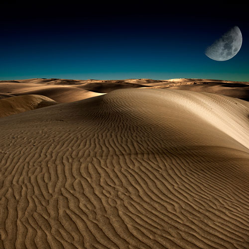 Mesmerizing view of the dunes of Erg Chigaga at night.