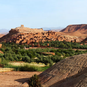 a gorgeous village and kasbahs are nestled in the desert of Greater Southern Morocco.