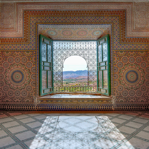 Peering out of a window of the ornately decorated Kasbah Telouet.